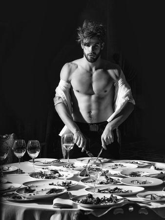 Menu for restaurant bar or pub. Handsome man stands at table