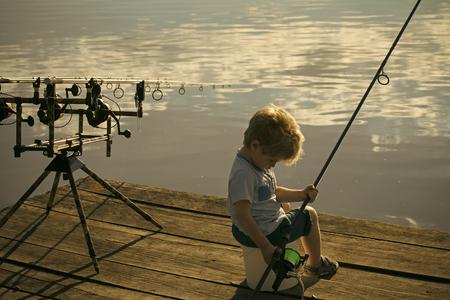 Fishing, angling. Cute boy fishing on river