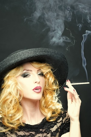Smoking retro woman 스톡 콘텐츠