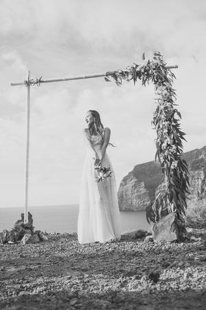 Wedding salon. Pretty girl or beautiful bride in white dress under arch