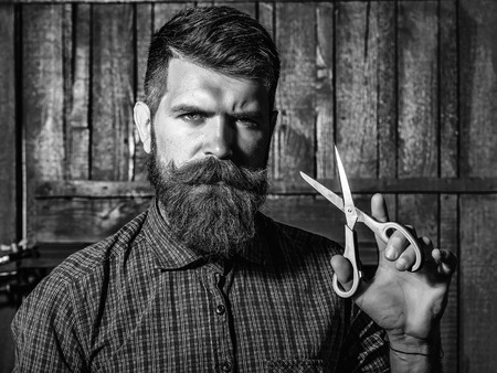 Barber shop. Hair style. bearded man barber with scissors