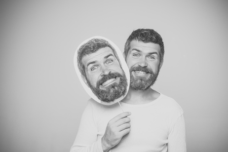 Funy face. man with long beard on happy face hold paper nameplate Banco de Imagens