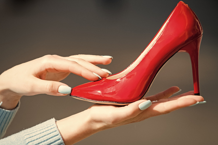 shoe shop. footwear or shoe red color leather on female hand Stock Photo