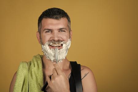 man is shaving. Barber and hairdresser. 写真素材