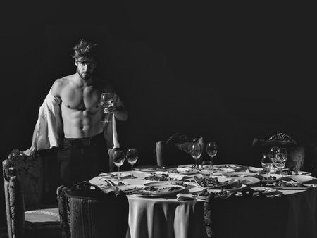 beautiful restaurateur. Hansome man in unbutton shirt Reklamní fotografie