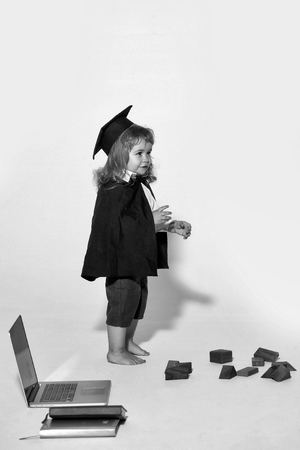 self-education. education boy with wooden blocks isolated