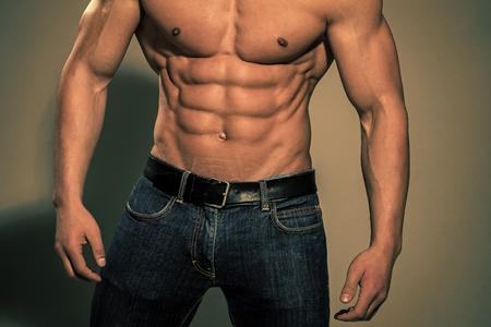 male press. Athletic bodybuilder man on grey background. Stock Photo