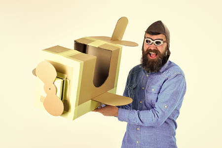 Dream, adventure. Bearded man father hold cardboard plane isolated on white. Stockfoto