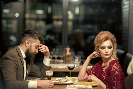 treason and resentment. Bad date of couple, break up relations and love. couple with misunderstanding at restaurant. Business meeting of man and woman. Valentines day with woman and man. Dislike makes conflict and divorce Stockfoto - 102697459