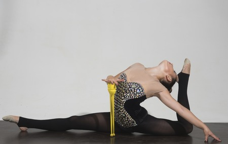split of woman with mace. split pose of woman with mace. Stock Photo