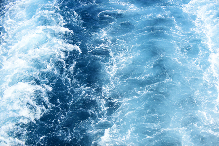 Swirl of speed boat on blue sea water surface. Seascape with waves and foam. Holiday destination and travelling. Adventure and wanderlust.