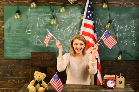 Happy independence day of the usa. Back to school or home schooling with teacher. Patriotism and freedom. Woman in classroom with American flag at knowledge day. School lesson in 4th of july