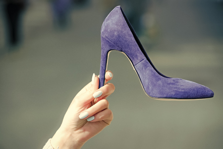 Sale in the shoe. glamour shoe blue color suede on female hand Stock Photo