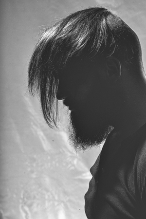 silhouette of a rough man. Stylish bearded man