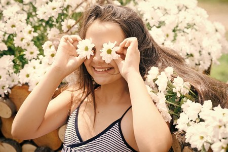funny girl. Beautiful happy young girl smile with camomile