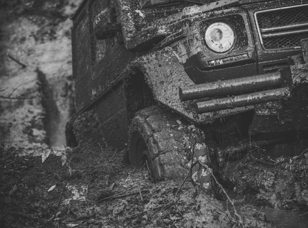 racing off-road cars. 4x4 or 4WD car with wheels in mud Stock Photo