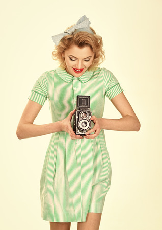 Woman with retro hair, makeup and old camera. media and new technology, journalism 版權商用圖片