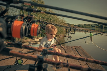 Fishing gear. Cute boy fishing fish