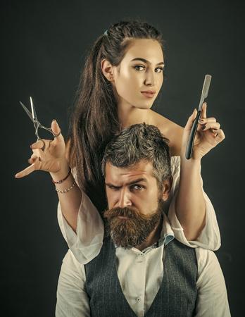 female hairdresser. Close-up female hairdresser cutting hair of man Фото со стока