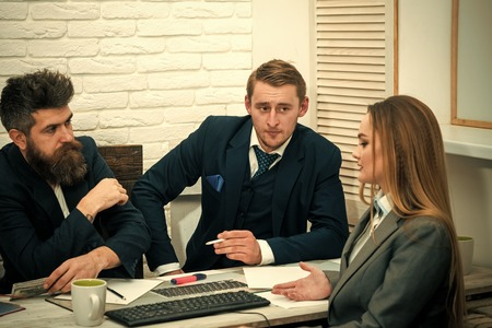 Business investment concept. Business partners, businessmen at meeting, office background. Business negotiations, bosses listening with interest business offer. Businesswoman ask for investment Banque d'images - 103093489