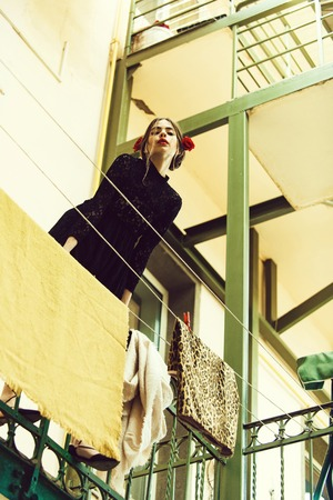 Fashion portrait. girl hanging clothes on laundry line with peg Stok Fotoğraf