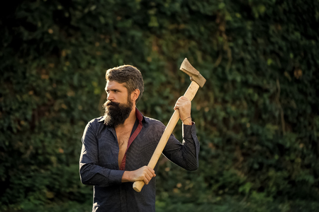 man with an ax. an elegant logger. Man with sharp axe Stock Photo