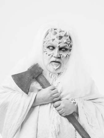 Monster with thorns and beard on face. Demon with axe in hands on white background