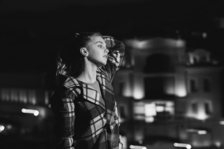night city. city and night with girl, blonde model in checkered coat