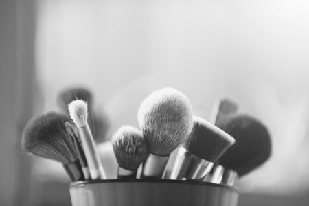 beauty, visage and design. makeup brush for fashionable cosmetic in pink cup Stock Photo