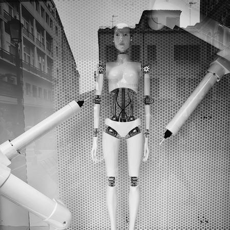 Robot stands in glass window Reklamní fotografie