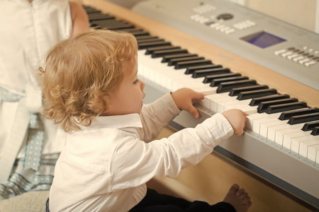 young genius virtuoso. Boy play on digital piano