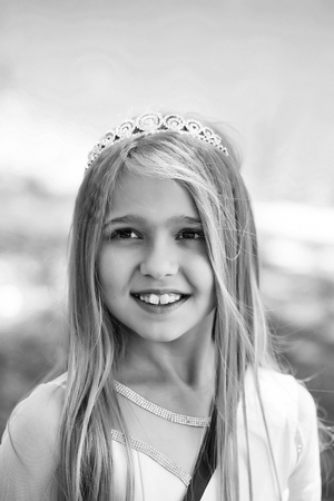 little cinder. small girl in princess crown Stock Photo