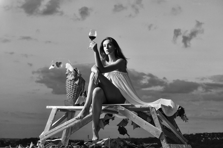 advertising wine. pretty woman with wine over sky Banque d'images - 103265012