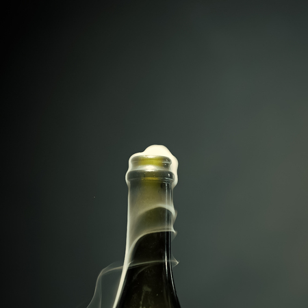 open bottle with champagne. Champagne bottle with smoke Imagens