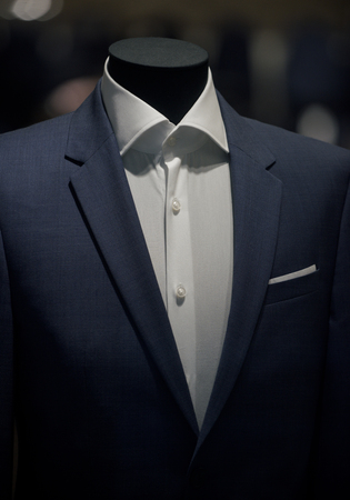 Suit jacket and white shirt on mannequin. Fashion mannequin in shop. Fashion and style. Business or formal wear. Shopping and sale
