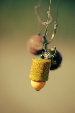 fishing tackle. Fishhooks on line on blurred background
