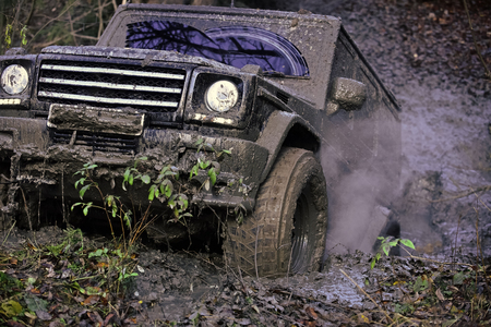 off-road. Reduced gear concept. Dirty offroad car rides with obstacles