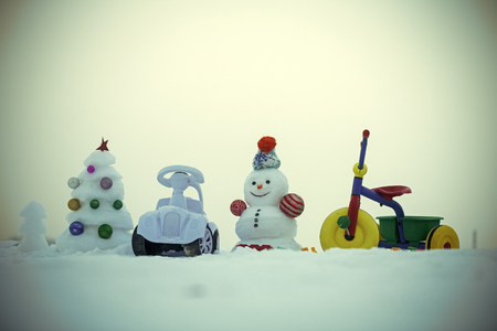 Christmas and new year. Snowman and snow xmas tree on blue sky