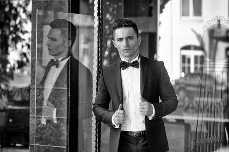 man in a tuxedo. Young man in suit