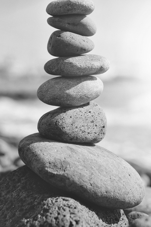 Zen. Harmony of the soul and nature. Grey stones or pebbles stacked in pyramid