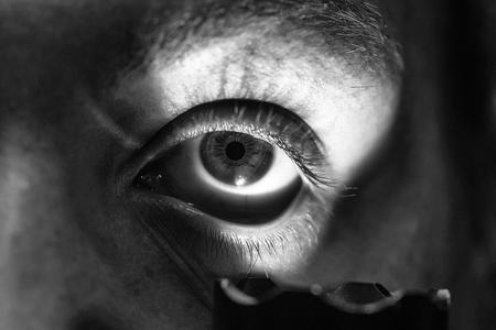 ophthalmology. male eye with flashlight
