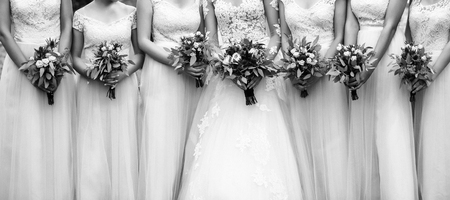 bride with girlfriends. Bridesmaids with beautiful bridal bouquets
