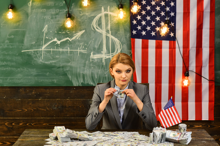 Woman with dollar money for bribe. American education reform at school in july 4th. Independence day of usa. Economy and finance. Patriotism and freedom. Income planning of budget increase policy Stock fotó