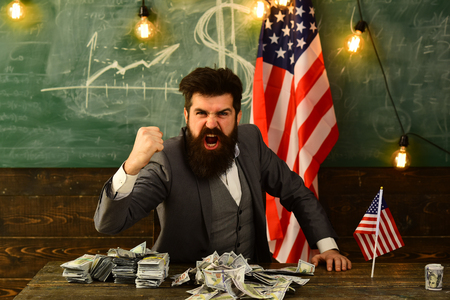 Politician: Man with US Currency at usa flag.