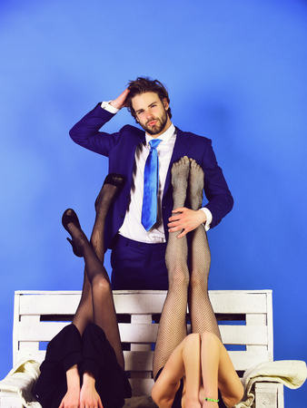 office romance, sexual services man or businessman in suit and female sexy legs Stock fotó