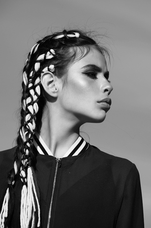 Beauty and fashion. Hairdressing salon. Beauty fashion portrait. Adorable girl with cute face, makeup and stylish braids