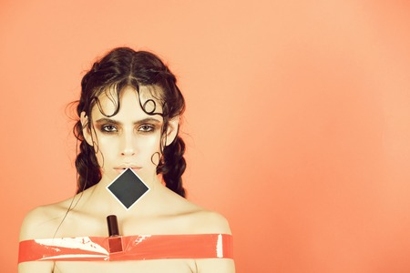 female fashion portrait. Cute girl taped in rosy sticky tape and Stock Photo