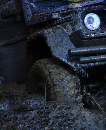 Extreme entertainment concept. Offroad tire covered with mud Reklamní fotografie