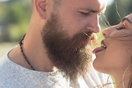Kiss me right now. Sensual woman stick out tongue to man. Couple in love. Feeling flirty. Bearded man and woman enjoy intimacy