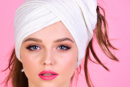 Fashion and spa beauty. Morning after bath washing and hair clean. Housewife has makeup with towel or headscarf. Sexy woman with towel on head after shower. Girl with fashionable turban on hair.